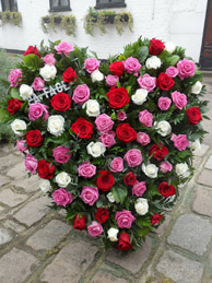 Heart shaped funeral cushion with roses